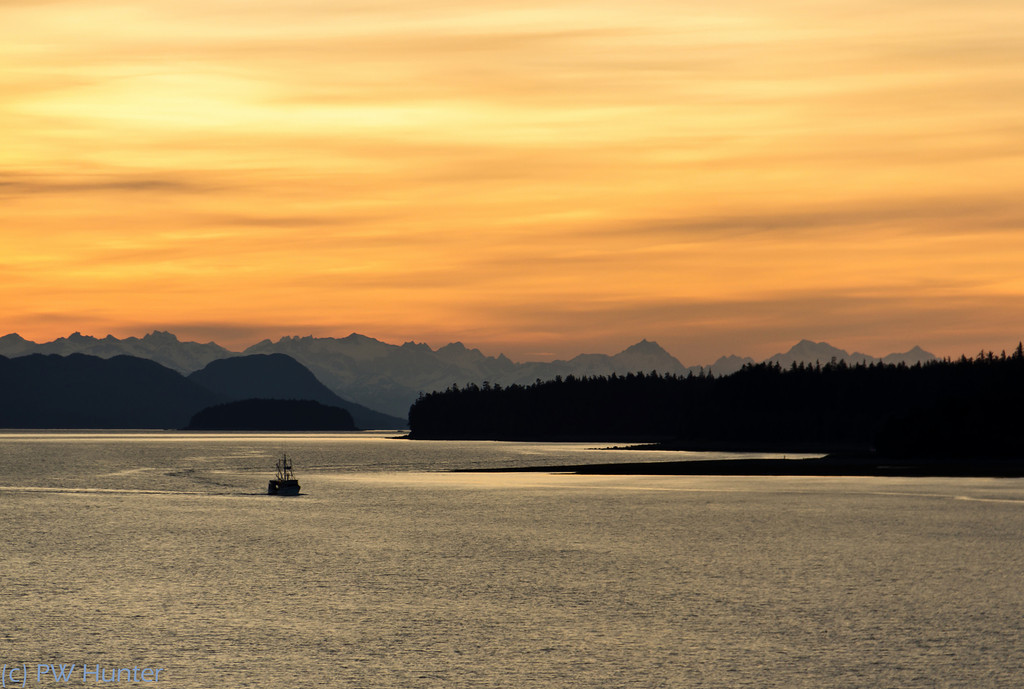 A fishing boat heading home in the waters of the inside passage.